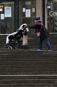 A woman pushing a disabled child in a wheelchair, Birmingham City Centre - Timm Sonnenschein - 2010s,2013,adult,adults,Birmingham,bound,boy,boys,care,carer,carers,caring,child,Child Carer,Child Carers,childcare,CHILDHOOD,CHILDMINDING,children,cities,city,disabilities,disability,disable,disabled