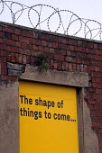 The shape of things to come... barbed wire and street art on a former entrance of a derelict factory, Sheffield - Timm Sonnenschein - 16-03-2013