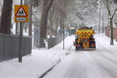An Amey/Birmingham City Council gritting lorry spreading salt by �Queensbridge School �in Birmingham �as continuous snowfall disrupts travel and transport - Timm Sonnenschein - 24-03-2013