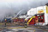 West Midlands Firefighters attending a fire that broke out in a Cash Converters shop, suspected arson, Kings Heath, Birmingham - Timm Sonnenschein - 27-03-2013