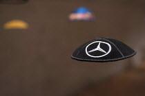 Mercedes Benz logo Kippah or Yarmulke, Jewish Museum, Berlin, Germany - Timm Sonnenschein - &,2010s,2013,ACE,advertisement,advertisements,advertising,arts,auto industry,automotive,BAME,BAMEs,belief,BME,bmes,brand,branding,cap,caps,Car Industry,carindustry,case,conviction,culture,design,displ