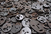 The Jewish Museum, Berlin, Shalechet (Fallen Leaves), Art in the Memory Void by the artist Menashe Kadishman. Over 10,000 open-mouthed faces coarsely cut from heavy, circular iron plates cover the flo... - Timm Sonnenschein - WW2,2010s,2013,3rd,ACE,anti semitic,Anti Semitism,antisemitic,Antisemitism,anti-Semitism,art,Art Gallery,artist,ARTISTS,arts,artwork,artworks,bigotry,camp,camps,chambers,concentration,culture,death,de