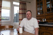Michael, in his council flat in Ladywood, Birmingham. He was asked to pay bedroom tax for two room, which would take him into debt. He initially moved in the house with his parents in 1970, later live... - Timm Sonnenschein - 08-05-2013
