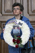Anti bedroom tax protest, Birmingham. Maria Brabiner from Manchester holding a wreath in memory of Stephanie Bottrill who committed suicide because she couldnt pay the bedroom tax - Timm Sonnenschein - 15-06-2013