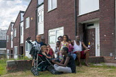A family outside their home, Druids Heath, Birmingham - Timm Sonnenschein - 2010s,2013,BAME,BAMEs,Birmingham,Black,BME,bmes,cities,city,diversity,Druid,Druids,EQUALITY,ethnic,ethnicity,excluded,exclusion,families,family,HARDSHIP,home,Housing Estate,impoverished,impoverishment