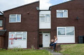 Youth hanging around outside their home, Druids Heath, Birmingham - Timm Sonnenschein - 25-07-2013