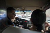 A Taxi driver speaking with a passenger, Shanghai, China - Timm Sonnenschein - 22-08-2013