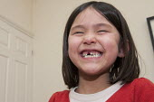 A six year old girl with a tear on her cheek and a gap of a just pulled out milk tooth - Timm Sonnenschein - 1st,2010s,2013,asian,asians,BAME,BAMEs,BME,bmes,child,CHILDHOOD,children,chinese,cities,city,diversity,EMOTION,EMOTIONAL,EMOTIONS,ethnic,ethnicity,female,females,first,funny,girl,girls,HAPPINESS,happy