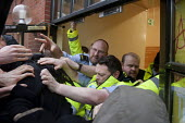 Student protesters clash with security guards as they try to enter the Aston Webb building. National Student Protest for free education, against cuts and �the privatisation of student loans, Universit... - Timm Sonnenschein - 29-01-2014