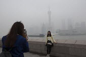 Tourists taking pictures as dense smog due to pollution covers the Shanghai skyline, Pudong, China - Timm Sonnenschein - (NO2), Chinese,2010s,2014,ACE,Air Quality,Amateur Photographer,architecture,blocks,building,buildings,camera,cameras,China,cities,city,City centre,cityscape,cityscapes,Climate Change,degradation,dioxi