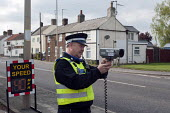 PCSO taking speed measurements on a rural village road to raise speeding awareness amongst drivers, Spalding, Lincolnshire - Timm Sonnenschein - 22-04-2014
