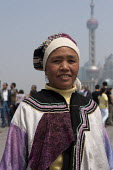 A woman wearing traditional cloths of the Nu ethnic minority from Yunnan Province at the Bund, Shanghai, China - Timm Sonnenschein - 09-04-2014