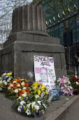 Placard mourning the death of Simon Jones at Euromin. Floral wreaths commemorating deaths at work and injured workers. The pillar is a memorial stone for workers that died during the construction of B... - Timm Sonnenschein - 28-04-2014