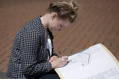 A sixth form art student drawing during an architectural outdoor lesson in Birmingham City Centre - Timm Sonnenschein - 10-07-2014