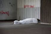 Homeless man sleeping rough in an underpass, Paradise Circus, Birmingham - Timm Sonnenschein - ,2010s,2014,asleep,Birmingham,cities,city,EQUALITY,excluded,exclusion,EXHAUSTION,HARDSHIP,homeless,homelessness,impoverished,impoverishment,INEQUALITY,Marginalised,Paradise,people,POOR,poverty,precari
