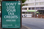 Don't Lose Your Tax Credits, HMRC roadside advert for Working Tax Credit and Child Tax Credit - state benefits, opposite the Ladywood Job Centre Plus, Birmingham - Timm Sonnenschein - 10-07-2014
