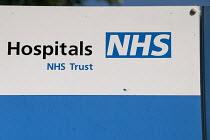 NHS Trust sign, Birmingham City Hospital - Timm Sonnenschein - HEA,2010s,2014,Birmingham,care,communicating,communication,HEA,Health,HEALTH SERVICES,healthcare,hospital,hospitals,logo,national health service,NHS,PEOPLE,PUBLIC SERVICES,service,services,sign,signs,