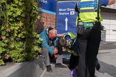 British Transport PCSOs attending an injured homeless man, New Street Station, Birmingham - Timm Sonnenschein - 26-09-2014