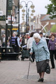 Elderly shopper, Northampton - Timm Sonnenschein - 2010s,2011,adult,adults,age,ageing population,bought,buy,buyer,buyers,buying,cities,city,commodities,commodity,consumer,consumers,customer,customers,elderly,fail,FEMALE,frailty,goods,High St,High Stre