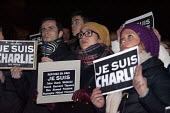 Je Suis Charlie vigil for the twelve people, who died during the terror attack at the office of the French satirical magazine Charlie Hebdo in Paris. Victoria Square, Birmingham. - Timm Sonnenschein - ,2010s,2015,activist,activists,at,attack,attacking,BAME,BAMEs,black,BME,bmes,CAMPAIGN,campaigner,campaigners,CAMPAIGNING,CAMPAIGNS,cartoon,CARTOONS,child,CHILDHOOD,children,crime,cultural,DEMONSTRATIN