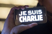 Je Suis Charlie vigil for the twelve people, who died during the terror attack at the office of the French satirical magazine Charlie Hebdo in Paris. Victoria Square, Birmingham. - Timm Sonnenschein - ,2010s,2015,activist,activists,at,attack,attacking,CAMPAIGN,campaigner,campaigners,CAMPAIGNING,CAMPAIGNS,cartoon,CARTOONS,CELLULAR,child,CHILDHOOD,children,communicating,communication,crime,DEMONSTRAT