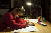 A year three school girl doing her maths homework, Birmingham - Timm Sonnenschein - 2010s,2015,arithmetic,asian,asians,BAME,BAMEs,Birmingham,BME,bmes,child,CHILDHOOD,children,chinese,CONCENTRATE,concentrating,concentration,diversity,edu,educate,educating,education,educational,ethnic,