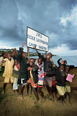 Refugee children from the D.R Congo crowd together holding the sign to their school, Gihembe, Rwanda, 2003 - Steven Langdon - 01-03-2003