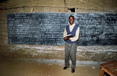 An English teacher at a class for refugee children from the D.R Congo at the Gihembe refugee camp, Rwanda, 2003 - Steven Langdon - 01-03-2003