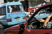 A strong sense of national pride within Jordanian society - one of many vehicles displaying images of both the past and present King of Jordan King Abdullah and his father the late King Hussein. Amman... - Steven Langdon - 01-03-2004