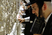 Orthodox Jews praying at the western wall - also known as the wailing wall - in the Old City. Jerusalem, Israel, 2005 - Steven Langdon - 28-10-2005