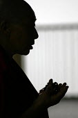 A tibetan nun prays at the Namgyal monastery in Mcloedganj, India. - Tashi Tobgyal - 11-10-2007
