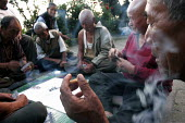 Retired Tibetan refugees enjoy their time playing cards at the Elders home in Mcloedganj, Dharamsala. - Tashi Tobgyal - 2000s,2007,activity,age,Asia,asian,asians,Card Game,cards,cigarette,cigarettes,Dharamsala,Diaspora,displaced,down,Elder,elders,foreign,foreigner,foreigners,game,games,group,groups,hand,hands,Himachal,