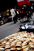 Locally made biscuits selling in Old Delhi, India - Tashi Tobgyal - 2000s,2007,Asia,asian,asians,auto-rickshaw,auto-rickshaws,biscuit,biscuits,buy,buyer,buyers,buying,cake,cakes,cities,city,commodities,commodity,cycle,cycles,Delhi,EBF Economy,fast,fast food,fast food,