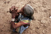 A Gondi tribal woman from Beemanagundi in Andhra Pradesh, she sits on a parched piece of land. - Tashi Tobgyal - 11-10-2007