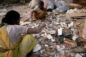 Ragpickers scavenge through a garbage dump in New Delhi, India. - Tashi Tobgyal - 07-12-2007