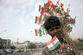 A young boy sells national flags in order to raise living wages for his family in New Delhi, India. Even though many laws prohibiting child labour has been passed in the State, the scene on the roads... - Tashi Tobgyal - 25-01-2008