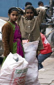 Young children picking trash in New Delhi. Even though many laws prohibiting child labour has been passed in the State, legislation has proved ineffective. - Tashi Tobgyal - 25-01-2008