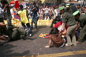 A street play of how Chinese authorities have been opressing Tibetans in Tibet. Tibetans in New Delhi protest on the 49th Tibetan Uprising Day. Since the illegal occupation of Tibet by China in 1959,... - Tashi Tobgyal - 13-03-2008