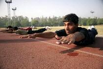 Blind Athletes training for the International Blind Athletics, Delhi, India - Tashi Tobgyal - 2000s,2007,Asia,asian,asians,Athlete,Athletes,Blind,Delhi,disabilities,disability,disable,disabled,disablement,incapacity,India,indian,indian subcontinent,Indians,male,man,men,minorities,needs,people,