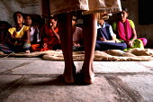 Children of Beedi workers attend a makeshift school built inside a tobbaco godown in Nasik, Maharashtra, India. - Tashi Tobgyal - 26-05-2009