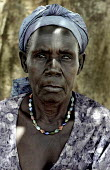 A Ugandan woman whose husband and two of her children were killed when the Lord's Resistance Army   - LRA - attacked the IDP camp where they live. She now cares for two orphaned children in an IDP w... - Thomas Morley - 07-03-2005