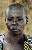 A Ugandan woman whose husband was killed by the Lord's Resistance Army in 1994 - then in 2004 the LRA abducted and killed her seven children and destroyed her house. She now lives alone in an IDP with... - Thomas Morley - 2000s,2005,acholi,adult,adults,africa,african,Africans,alone,Army,camp,camps,conflict,conflicts,crimes,displaced,displacement,east,FAMILY,FEMALE,husband,ID,idp,idps,internally,Internally Displaced Per