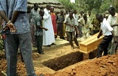The funeral of a man married with five children, who was one of three villagers killed by LRA rebels while they tried to protect his village from an attack. Three other men were abducted and killed ne... - Thomas Morley - 2000s,2005,africa,african,Africans,army,burial,casket,cemeteries,cemetery,ceremonies,ceremony,CHILD,CHILDHOOD,children,christian,christianity,christians,coffin,coffins,conflict,conflicts,dead,dead bod