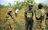 UPDF soldiers break during the search for three men abducted by the LRA and found soon after dead nearby. Gulu, northern Uganda 2005 - Thomas Morley - 16-03-2005