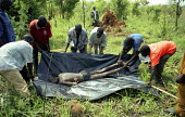 UPDF soldiers find the body of a villager who was one of three villagers abducted and killed by LRA rebels while they tried to protect their village from an attack. Gulu, northern Uganda 2005 - Thomas Morley - 16-03-2005