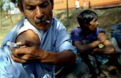 Bangladeshi drug users injecting with a synthetically produced opiate called Bupererorphine. This drug is supplied to the drug users, along with clean needles and syringes as part of a program to supp... - Thomas Morley - 2000s,2002,Acquired immune,addict,addiction,addicts,against,AIDS,arm,asia,asian,asians,Bangladesh,Bangladeshi,Bangladeshis,buprenorphine,cities,city,CLJ,deficiency syndrome,developing,drug,drug users,