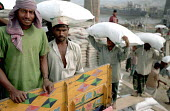 Trucks being loaded in Dhaka - many of the long distance truck drivers use prostitutes along the main highways so spreading the AIDS epidemic within Bangladesh. 2002 - Thomas Morley - 05-03-2002