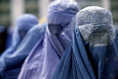 Afghan women wearing the traditional burka at a support centre for women who have been widowed by the Afghan civil war. The centre offers them food rations on a monthly basis. Kabul , Afghanistan 2002 - Thomas Morley - &,2000s,2002,afghan,afghanistan,afghans,apparel,asia,belief,burka,burkas,burqa,burqas,charitable,charity,Civil War,clothes,clothing,conflict,conflicts,conviction,developing,dress,EQUALITY,excluded,exc