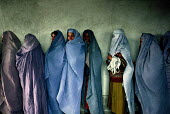 Afghan women wearing the traditional burka at a support centre for women who have been widowed by the Afghan civil war. The centre offers them food rations on a monthly basis. Kabul , Afghanistan 2002 - Thomas Morley - &,2000s,2002,afghan,afghanistan,afghans,apparel,asia,belief,burka,burkas,burqa,burqas,charitable,charity,Civil War,clothes,clothing,communities,community,conflict,conflicts,conviction,developing,dress