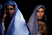 Afghan woman at a support centre for women who have been widowed by the Afghan civil war. The centre offers them food rations on a monthly basis. Kabul , Afghanistan 2002 - Thomas Morley - &,2000s,2002,afghan,afghanistan,afghans,age,ageing population,apparel,asia,belief,burka,burkas,burqa,burqas,charitable,charity,Civil War,clothes,clothing,conflict,conviction,developing,dress,elderly,E